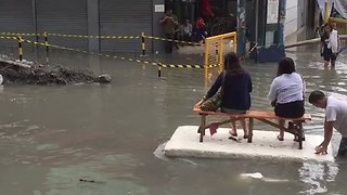 Manila Residents Ride on Makeshift Rafts in Flooded Street - Video