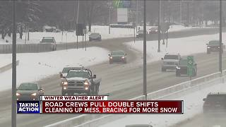 Crews cleaning roads after snow storm