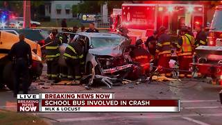 School bus, car crash near MLK and Locust in Milwaukee - Video