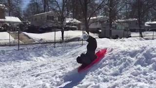 Sledding Fail: Boy Does Forward Flip Because His Sled Got Stuck On Slope - Video