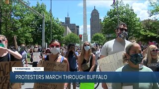 Hundreds of protestors peacefully march through the streets of Buffalo