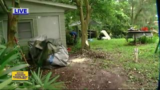 Volunteers give back to veterans with cleanup - Video