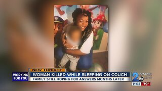 Woman killed while sleeping on couch