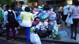 Local community gather donations for Grenfell Tower fire victims - Video