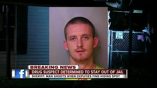 Barricaded suspect hiding in false wall dies after shootout with Polk deputies - Video