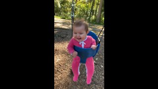 Baby girl can't stop giggling during first ever swing ride