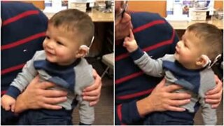 Child's emotional reaction to hearing for the first time