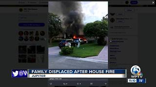 Fire crews save family dog from house fire in Jupiter - Video