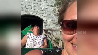 Woman freaks out during first roller-coaster ride - Video