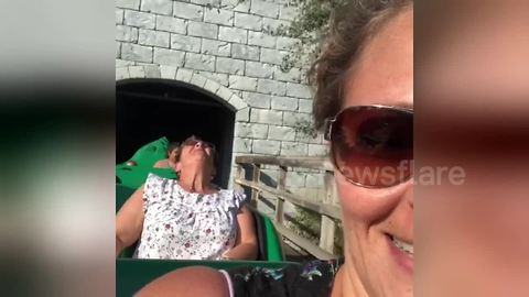 Woman freaks out during first roller-coaster ride