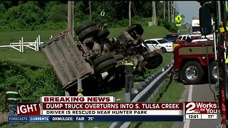 Dump truck overturns in Hunter Park creek