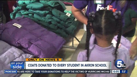 Coats donated to entire student body at Firestone Park Elementary School through Operation Warm