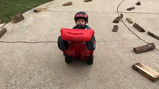 Terrified Toddler Pulls Off Epic Wheelie - Video