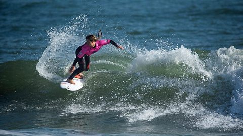 Teenage girl becomes youngest ever rookie to win world surfing league championship, at just fifteen year old