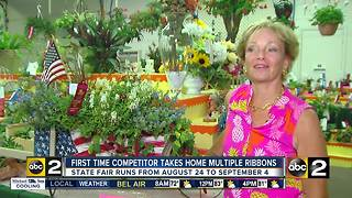 First-time competitor takes home multiple ribbons at State Fair Flower Show - Video