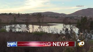Divers search water for possible body - Video