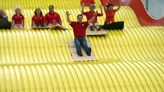 Governor Scott Walker rides the Giant Slide to kick off the 2018 Wisconsin State Fair - Video