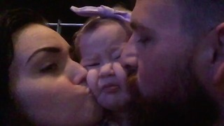 Baby girl demands hugs and kisses from parents