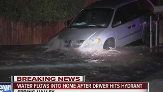 Minivan lands on fire hydrant in Spring Valley, water rushes into nearby home - Video