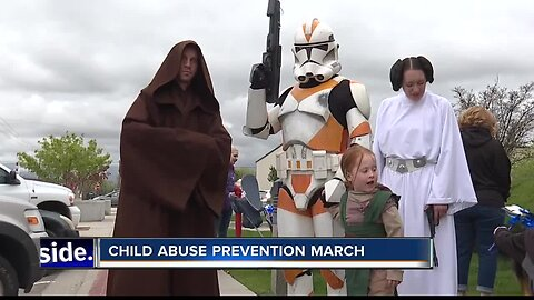 Superheroes march to prevent child abuse
