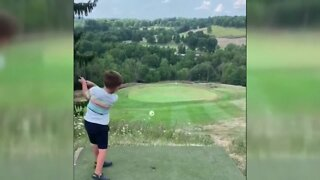 4-year-old boy tees up a hole-in-one