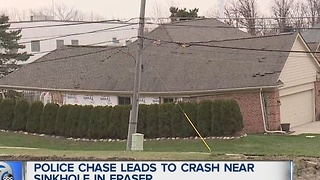Police chase leads to crash near sinkhole in Fraser - Video