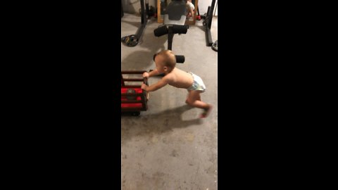 Baby trains for strongman competition