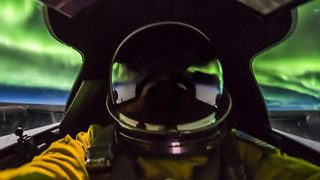 Air Force pilot flies right through aurora, capturing stunning images - Video
