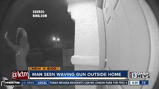 Man caught waving gun outside NLV home