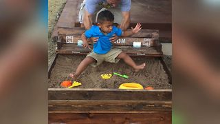 Toddler Hilariously Avoids Sandbox - Video