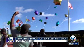 People show support for Reggie Dee's unity walk - Video
