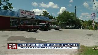Uber driver accused of punching passenger - Video
