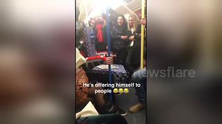 Commuter dresses up as London Underground seat - Video