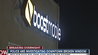 Tulsa Police investigate broken window at midtown real wireless store - Video
