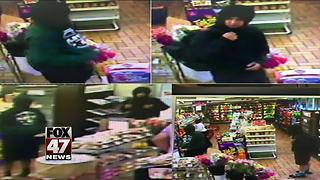 Police searching for suspects after attempted armed robbery - Video