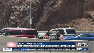 Man barricades himself in vehicle along U.S. 93 - Video