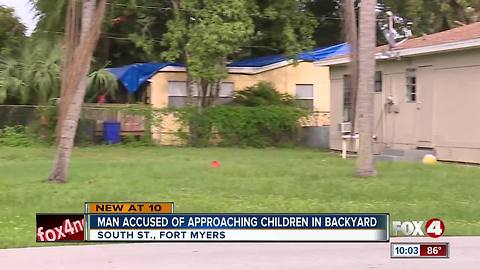 Man approaches kids playing in backyard
