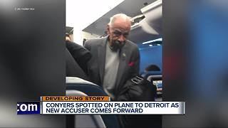 John Conyers spotted on plane to Detroit as new accuser comes forward - Video