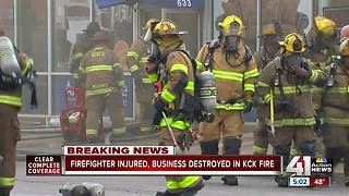 Firefighter injured, business destroyed in fire - Video