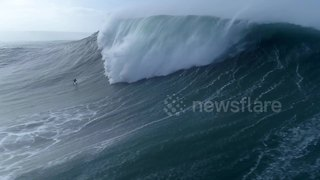 Spectacular drone footage captures surfer getting 'eaten alive' by monster wave - Video