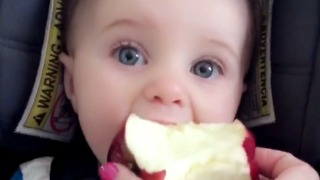Baby tries apple for the very first time