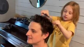Dad lets daughter cut his hair