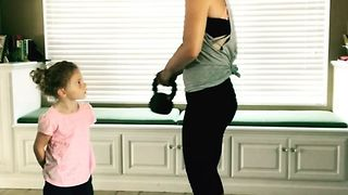 Mom and Little Girl Workout Together With Kettlebells - Video