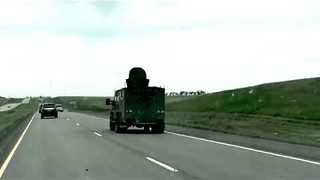 Driver Gets First Hand Look at Nuclear Missile Convoy - Video