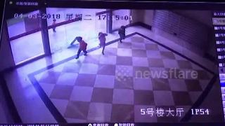 CCTV captures sliding glass door shattering over little children - Video