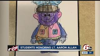 Students honored Lt. Allan with notes on officer cruisers during funeral service - Video