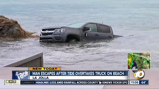 Man escapes after tide overtakes truck