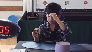 8-Year-Old Kid Solves Rubik's Cube While Blindfolded