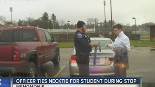 Officer ties necktie for student during traffic stop - Video