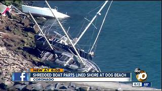 Debris from abandoned boat lined dog beach
